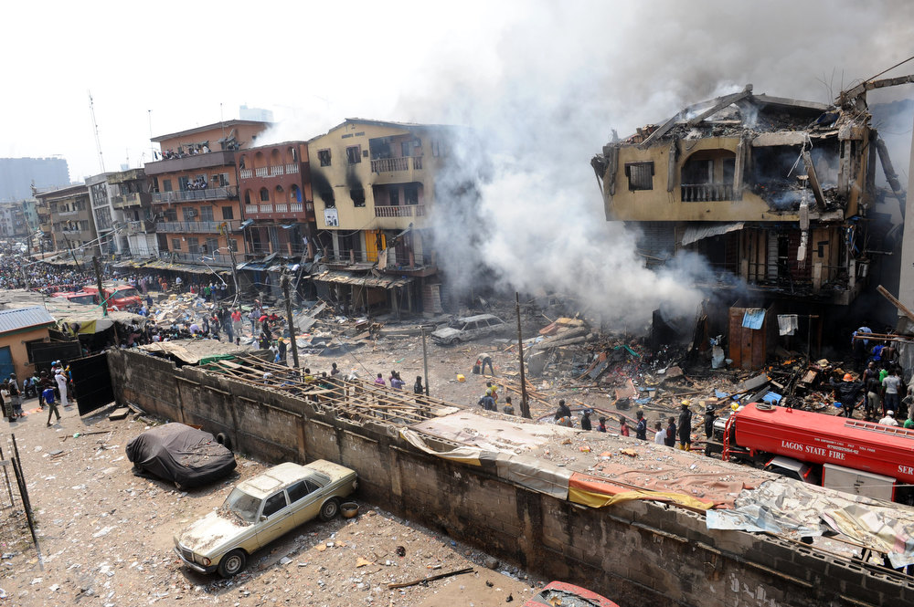 Description of . Building stocked with fireworks on fire in Lagos Island on December 26, 2012.  A strong explosion hit a building believed to be storing fireworks for the Christmas and New Year festivals in the sprawling Lagos Island, the oldest and most denely packed neighbourhoods in the Nigerian economic capital Lagos.  AFP PHOTO/PIUS  UTOMI EKPEI/AFP/Getty Images