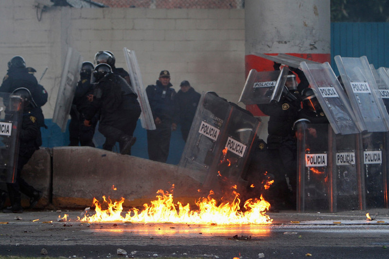 . Police protect themselves from a molotov cocktail during protests against Mexico\'s new President Enrique Pena Nieto outside congress in Mexico City December 1, 2012. Pena Nieto took over as Mexican president on Saturday, offering a shot at redemption for the party that shaped modern Mexico if he can bring about an end to years of violence and economic underperformance. REUTERS/Ginnette Riquelme