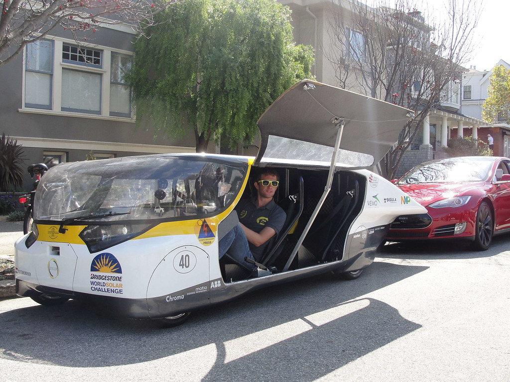 . Andre Snoeck, operations manager for Solar Team Eindhoven prepares to drive off in solar-powered family car \'Stella\' in San Francisco, September 22, 2014. GLENN CHAPMAN/AFP/Getty Images
