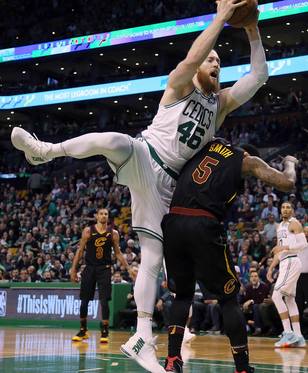 . Boston Celtics center Aron Baynes (46) grabs a rebound over Cleveland Cavaliers guard JR Smith (5) during the second half in Game 7 of the NBA basketball Eastern Conference finals, Sunday, May 27, 2018, in Boston. (AP Photo/Elise Amendola)