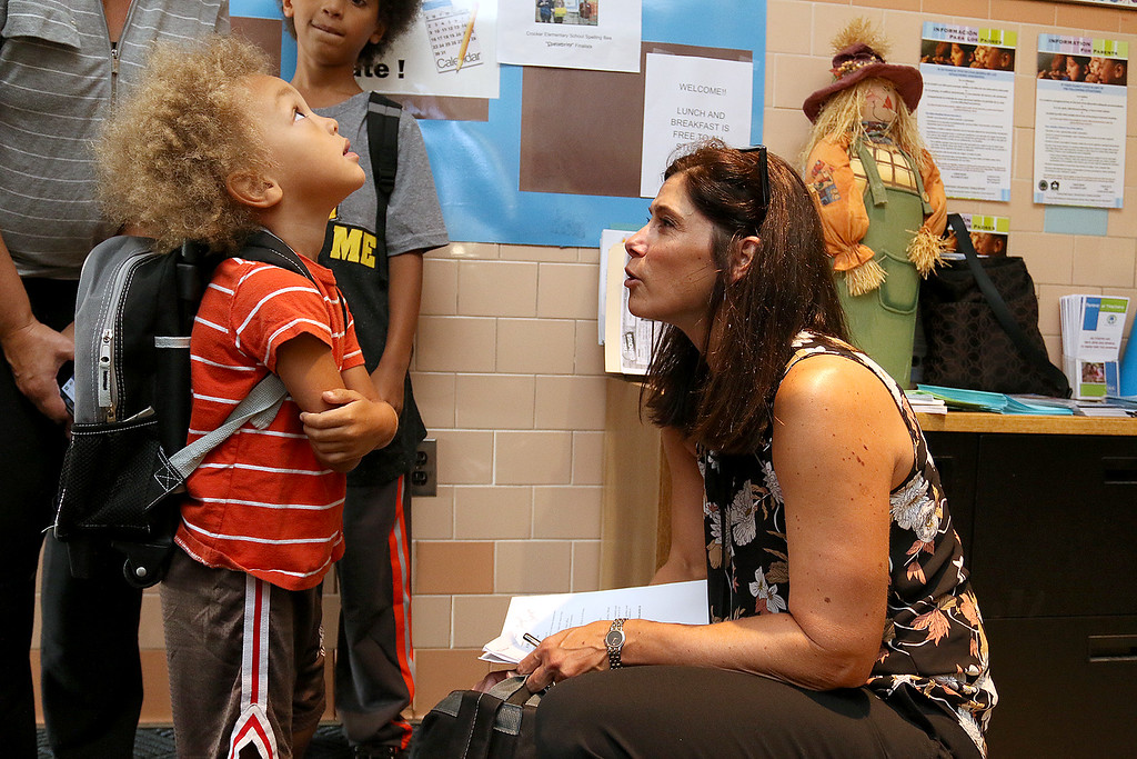 . The 2017-18 School year started  for Crocker Elementary School on Thursday, August 31, 2017. Administrator Christine Girard chats with pre-schooler Rashad Rhone just before the first day started. He will not start school till next week but was very excited so he came to help drop off his brother with his new backpack on. SENTINEL & ENTERPRISE/JOHN LOVE