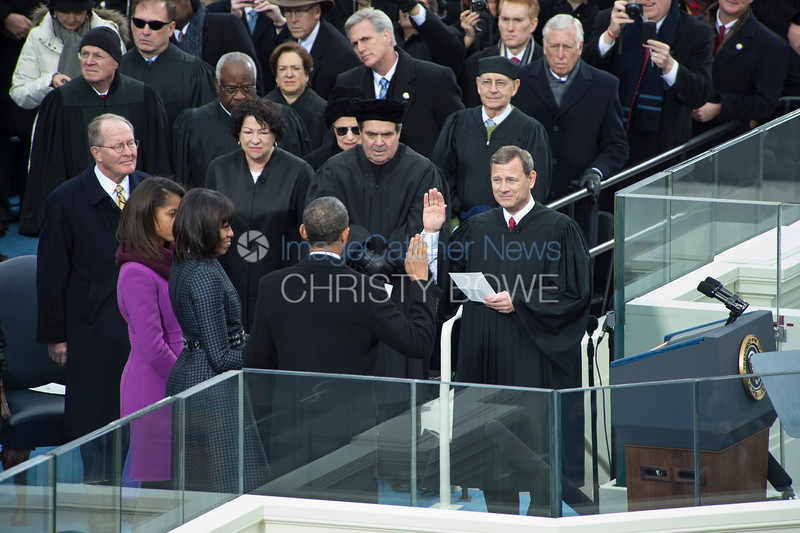 President Barack Obama is sworn in for his second term as President of the United States. Chief Justice John Roberts swears in President Obama.