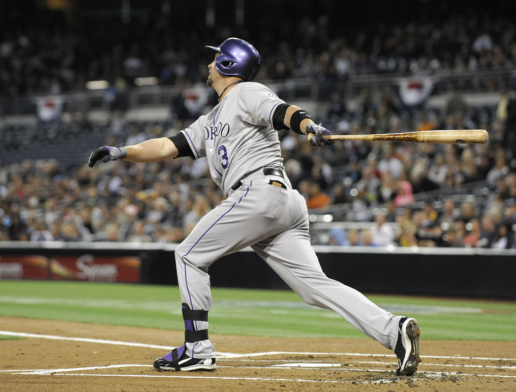 . SAN DIEGO, CA - APRIL 12:  Michael Cuddyer #3 of the Colorado Rockies hits an RBI single in the first inning during a baseball game against the San Diego Padres at Petco Park on April 12, 2013 in San Diego, California.  (Photo by Denis Poroy/Getty Images)