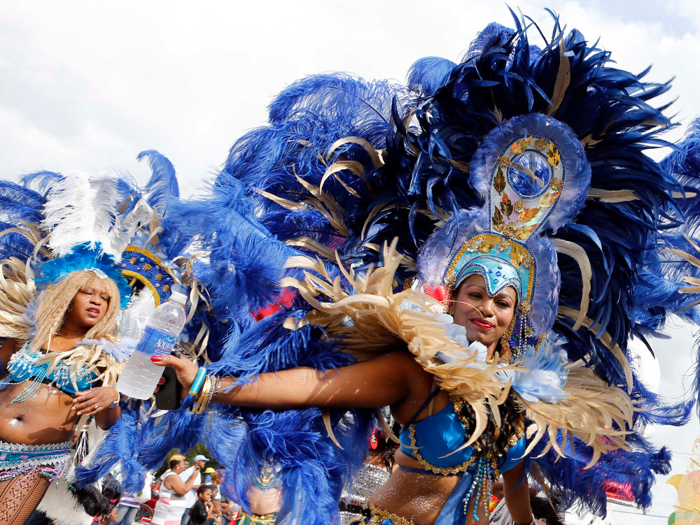 . Miami-Dade carnival dancers perform at the annual Martin Luther King Day parade in Miami, Monday, Jan. 21,  2013, as the nation honors civil rights leader Martin Luther King Jr. (AP Photo/Alan Diaz)
