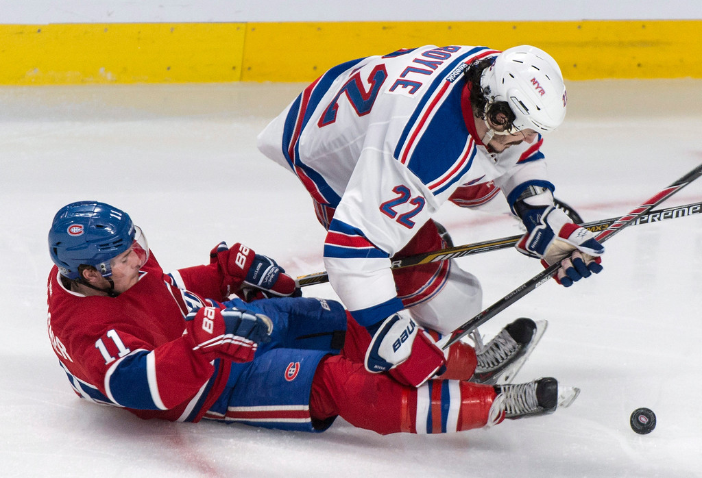. Montreal Canadiens\' Brendan Gallagher and New York Rangers Brian Boyle fall during the second period of Game 5 of the NHL hockey Stanley Cup playoffs Eastern Conference finals, Tuesday, May 27, 2014, in Montreal. (AP Photo/The Canadian Press, Paul Chiasson)
