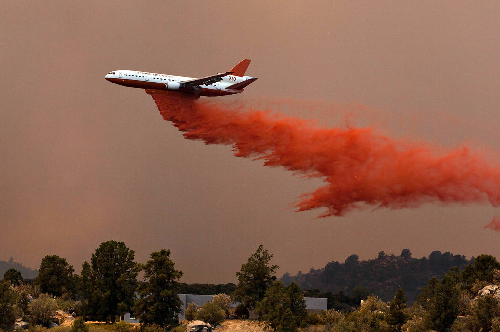 . Tanker 910 makes a retardant drop Yarnell Hill Fire to help protect the Double Bar A Ranch near Peeples Valley, Arizona, Sunday, June 30, 2013. The lightning caused blaze began on Yarnell Hill on Sunday. (AP Photo/The Arizona Republic, Tom Story)