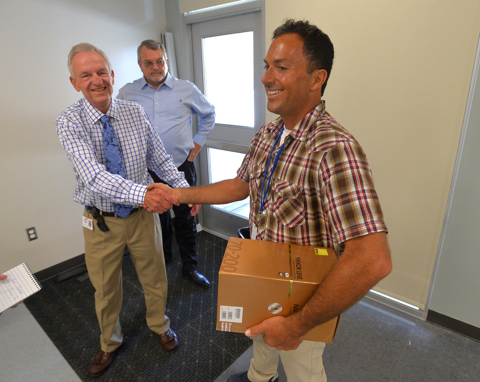 . Centinela Valley Union High School District Interim Superintendent Bob Cox, left, greets new Leuzinger High photo/video teacher Sean Hiller in his classroom in Lawndale, CA on Tuesday, August 19, 2014. Lawndale and Leuzinger high schools begin Wednesday and students will be working in new buildings that were constructed with bond money. (Photo by Scott Varley, Daily Breeze)