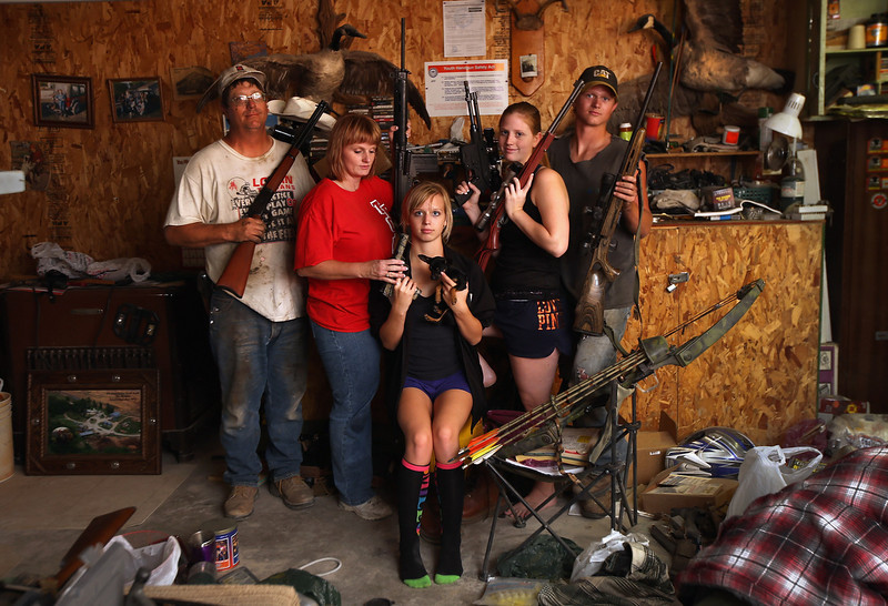 . The Becker family, including Darren, his wife Dorothy and their children Renee 15, Katie, 17 and Charlie, 19, show off a small part of the family weapons collection (and their pet Chiguagua Mini), at the Becker farm August 24, 2012 in Logan, Kansas. During hunting season later in the year, the Beckers host guests from around to country. Like many Kansas farmers affected by the record drought, the Beckers are working hard to hang on to their farm, which has been in their family for five generations. Most of Kansas is still in extreme or exceptional drought, despite recent lower temperatures and thunderstorms, according to the University of Nebraska\'s Drought Monitor. The record-breaking drought, which has affected more than half of the continental United States, is expected to drive up food prices by 2013 due to lower crop harvests and the adverse effect on the nation\'s cattle industry.  (Photo by John Moore/Getty Images)