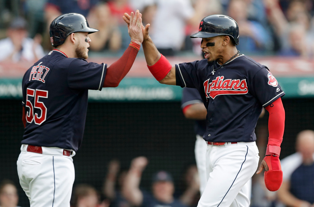 . Cleveland Indians\' Francisco Lindor, right, and Roberto Perez celebrate after both score on a two-run single hit by Michael Brantley in the third inning of a baseball game against the Houston Astros, Thursday, May 24, 2018, in Cleveland. (AP Photo/Tony Dejak)