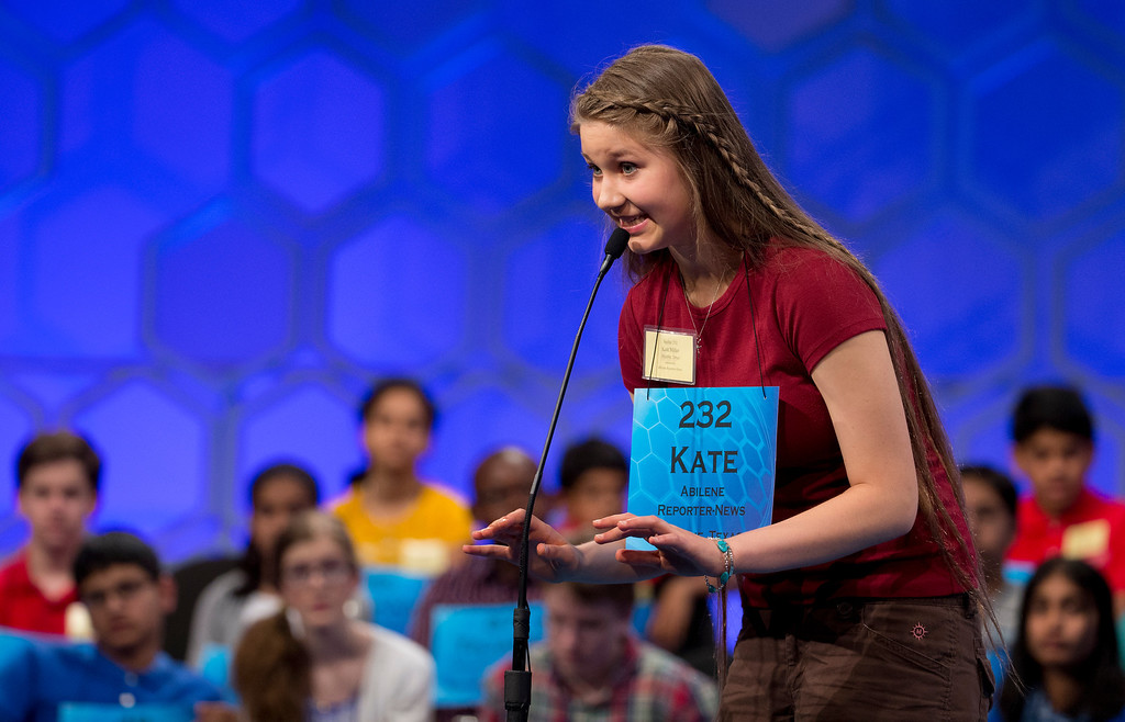". Eighth grade home-schooled student Kate Miller, 14, of Abilene, Texas, uses ""air typing\"" to visualize and spell her word \""duello\"", during the semifinals of the Scripps National Spelling Bee, Thursday, May 29, 2014, at National Harbor in Oxon Hill, Md. Miller spelled her word correct.  (AP Photo/Manuel Balce Ceneta)"