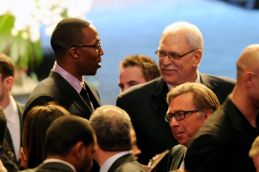 . Dwight Howard and Phil Jackson talk before the Jerry Buss Memorial Service at Nokia Theatre, Thursday, February 21, 2013. (Michael Owen Baker/L.A. Daily News)
