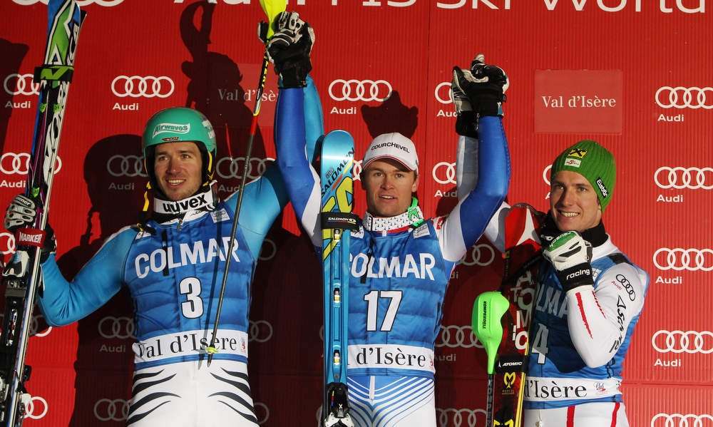Description of . From left, Germany's Felix Neureuther, second placed, France's Alexis Pinturault, the winner, and Austria's Marcel Hirscher, third, celebrate on podium after an alpine ski, men's World Cup slalom in Val d'Isere, France, Saturday, Dec. 8, 2012. (AP Photo/Alessandro Trovati)