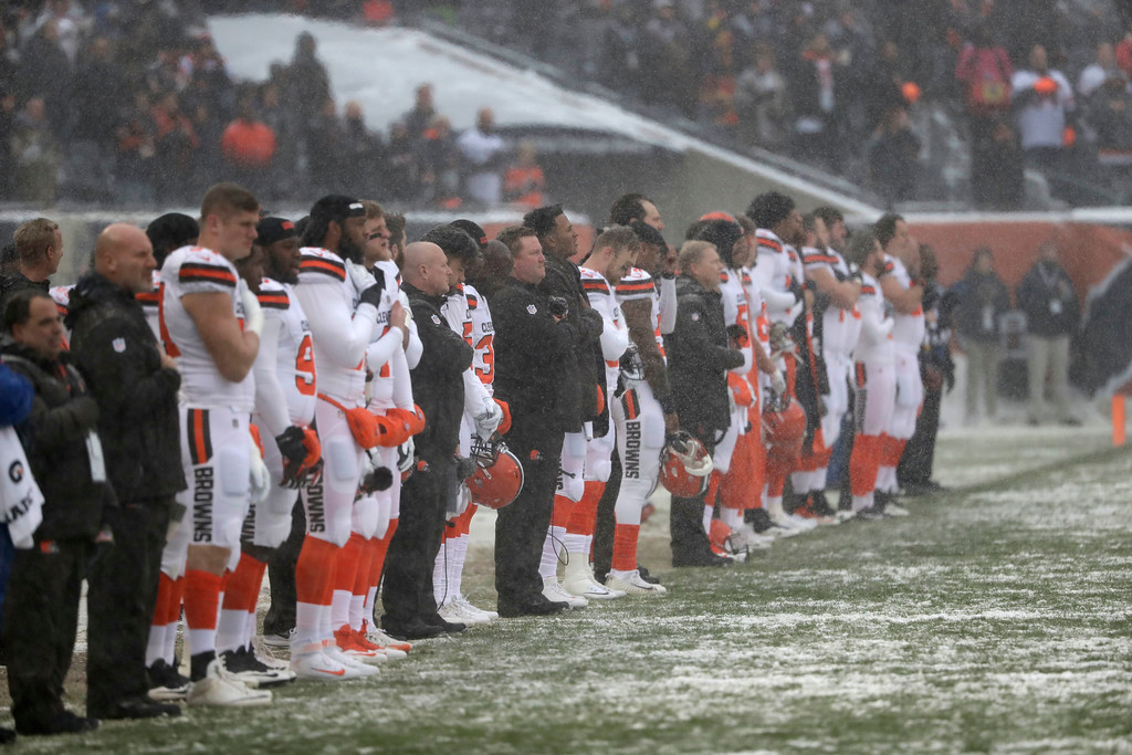 . Cleveland Browns line up in the snow for the national anthem before an NFL football game against the Chicago Bears in Chicago, Sunday, Dec. 24, 2017. (AP Photo/Charles Rex Arbogast)