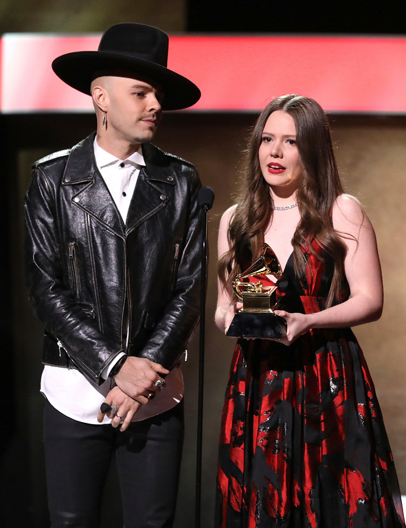 ". Jesse Huerta, left, and Joy Huerta of ""Jesse & Joy\"" accept the award for best latin pop album for \""Un Besito Mas\"" at the 59th annual Grammy Awards on Sunday, Feb. 12, 2017, in Los Angeles. (Photo by Matt Sayles/Invision/AP)"