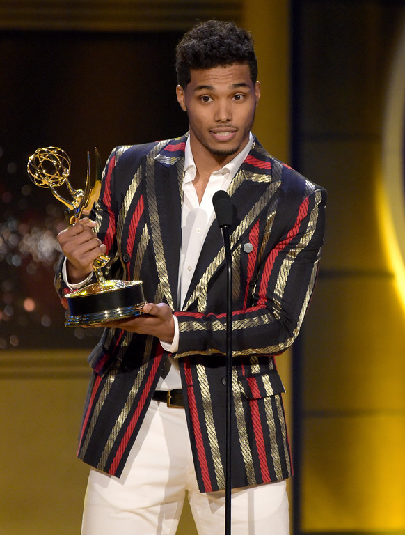 ". Rome Flynn accepts the award for outstanding younger actor in a drama series for ""The Bold and the Beautiful\"" at the 45th annual Daytime Emmy Awards at the Pasadena Civic Center on Sunday, April 29, 2018, in Pasadena, Calif. (Photo by Richard Shotwell/Invision/AP)"