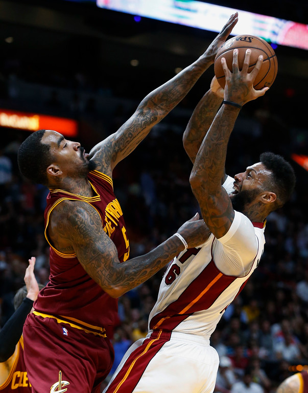 . Miami Heat forward James Johnson goes up for a shot against Cleveland Cavaliers guard JR Smith (5) during the second half of an NBA basketball game, Monday, April 10, 2017, in Miami. The Heat defeated the Cavaliers 124-121 in overtime. (AP Photo/Wilfredo Lee)