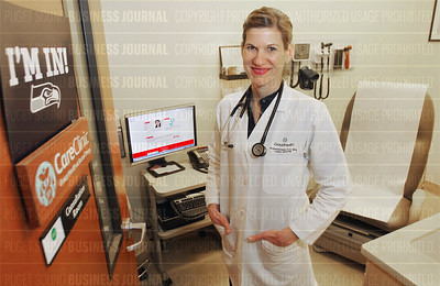 Group Health physician assistant Shannon Ries is pictured at the in-store Bartell Drugs' CareClinic in Seattle, Washington