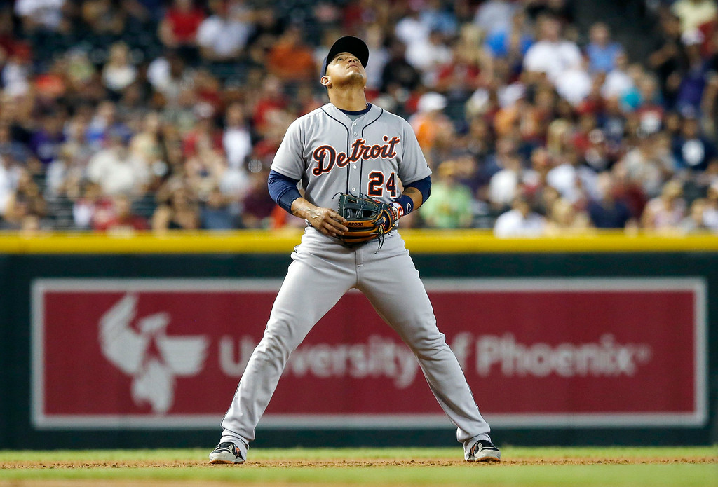 . Detroit Tigers\' Miguel Cabrera looks up into the sky to watch a home run ball hit by Arizona Diamondbacks\' Aaron Hill during the first inning of a baseball game on Tuesday, July 22, 2014, in Phoenix. (AP Photo)
