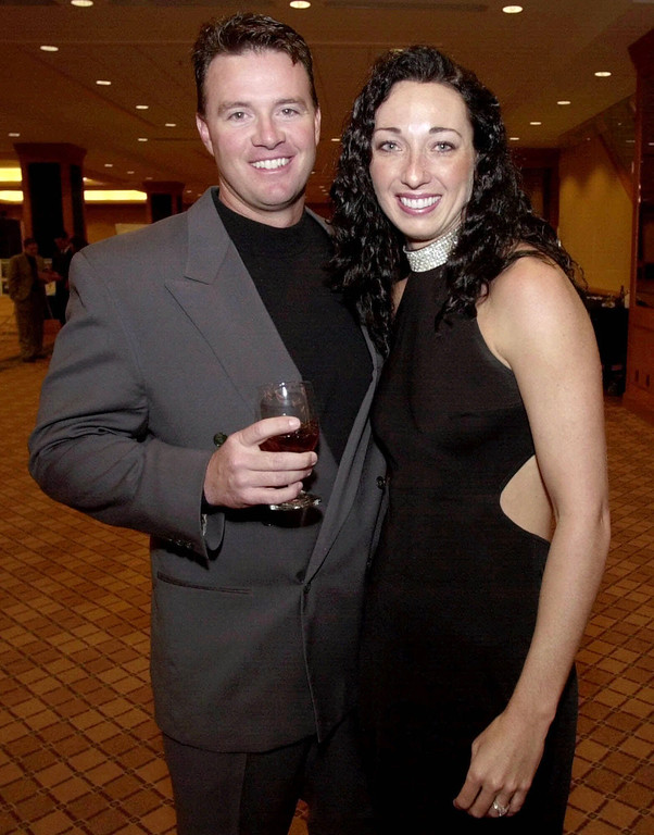 . In this March 1, 2001 file photo, Six-time Olympic gold medalist swimmer Amy Van Dyken, right, and Denver Broncos punter Tom Rouen pose before going into the Colorado Sports Hall of Fame dinner in Denver.  (AP Photo/David Zalubowski, File)