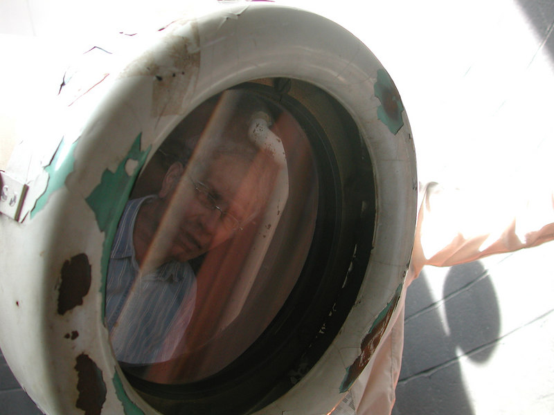 The reflection of Dave Smith appears in the objective of the Woodlawn Hills Telescope.