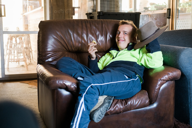 Relaxed Young Man Reclining in an Arm Chair