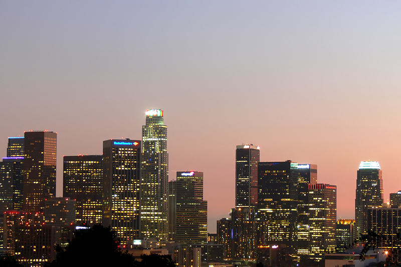 Downtown Los Angeles Skyline  Shot from near Elysian Park with a Panasonic FZ-30. Did not have a tripod, so we used a folding traffic workhorse along with a camera bag to stabilize the camera for a 3 sec.  exposure.  I took many shots, but the best were the ones that balanced the light of the buildings and background light.  The best color occurred after the sun went below the horizon.