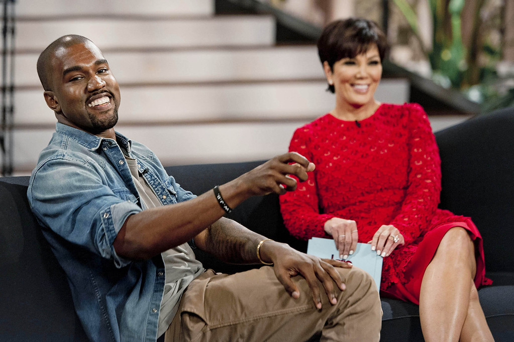 ". This Aug. 19, 2013 photo shows singer Kanye West, left, with host Kris Jenner during a taping of her talk show ""Kris,\"" in Culver City, Calif. West proclaims his love for Jenner\'s daughter, Kim Kardashian, and their daughter North in the interview airing Friday, Aug. 23.  (AP Photo/20th Century Television, Barry J. Holmes)"
