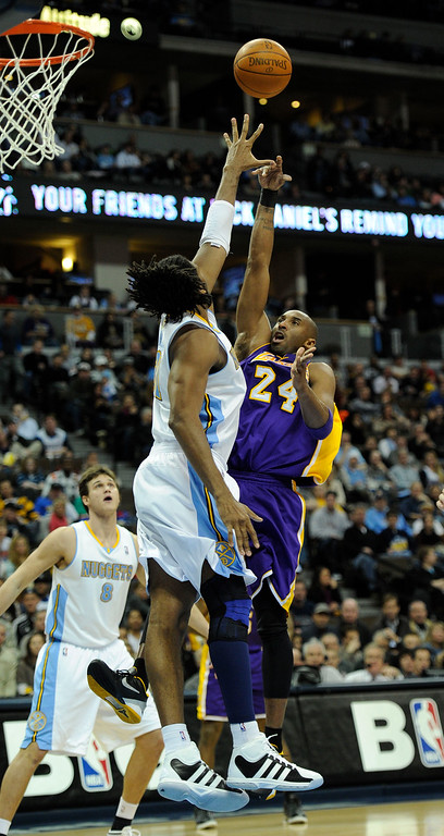 . Los Angeles Lakers shooting guard Kobe Bryant (24) takes a shot over Denver Nuggets center Nene (31) during the third quarter February 3, 2012 at Pepsi Center.  John Leyba, The Denver Post