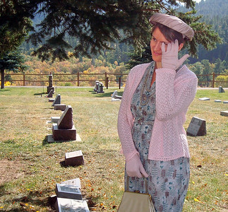 Angela Matthews (1914-2008) prepares for her presentation.  That's Kaija Swisher under the hat!