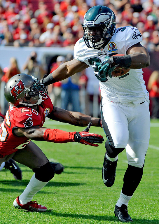 . Philadelphia Eagles running back Bryce Brown (34) fends off Tampa Bay Buccaneers defensive back Anthony Gaitor (26) during the first quarter of an NFL football game, Sunday, Dec. 9, 2012, in Tampa, Fla. (AP Photo/Brian Blanco)