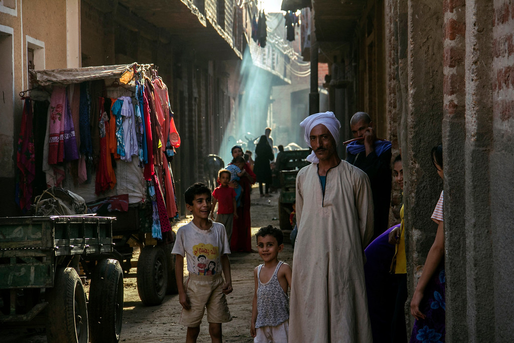 . In this Sept. 3, 2013 photo, Christian villagers gather in a narrow alley in Dalga, Minya province, Egypt. Dalga has been outside government control since hard-line supporters of the Islamist Mohammed Morsi drove out police and occupied their station on July 3, the day Egypt\'s military chief removed the president in a popularly supported coup. It was part of a wave of attacks in the southern Minya province that targeted Christians, their homes and businesses. (AP Photo/El Shorouk Newspaper, Roger Anis)