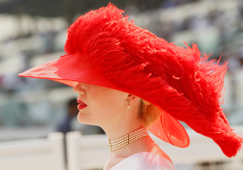 . A woman attends the Dubai World Cup horse race at Meydan Racecourse in Dubai, United Arab Emirates, Saturday, March 29, 2014. Ruler of the World could live up to his name in the $10 million Dubai World Cup when he starts as the 9-2 favorite at Meydan Racecourse on Saturday. (AP Photo/Kamran Jebreili)