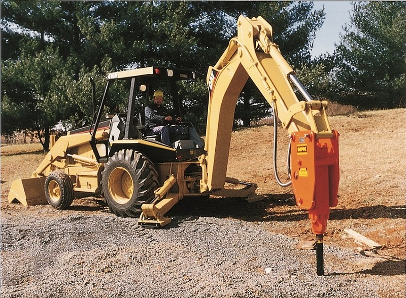 NPK H3XA hydraulic hammer on Cat backhoe (2).jpg