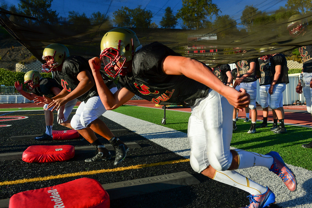 . Oaks Christian DE and TE Trevor Howard runs a drill at practice, Wednesday, August 20, 2014. (Photo by Michael Owen Baker/Los Angeles Daily News)