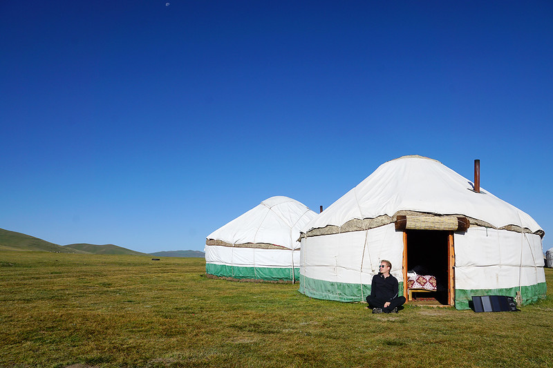 Sitting in front of a traditional yurt in Kyrgyzstan.jpg