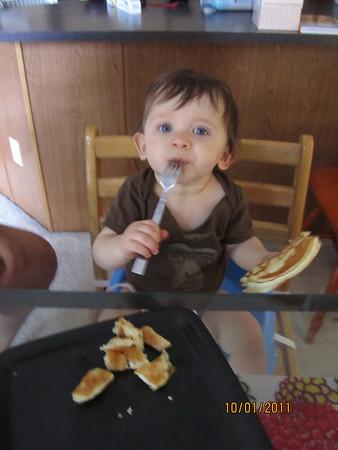 Titi feeds Mateo pancakes