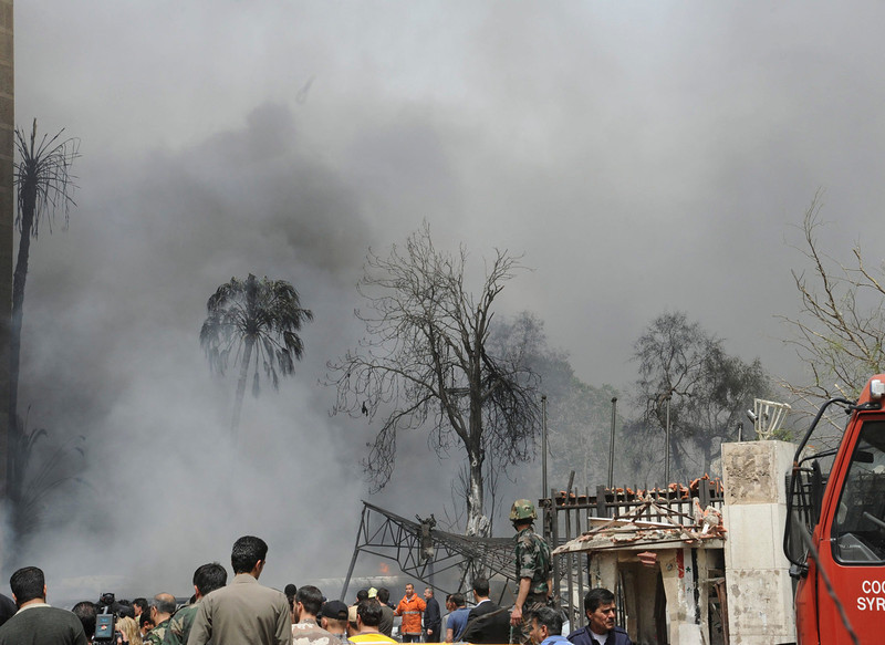 . A view shows smoke rising after a suicide car bomb exploded in the main business district of Damascus April 8, 2013, in this handout photograph distributed by Syria\'s national news agency SANA .The death toll from a suicide car bomb which exploded in central Damascus on Monday rose to 15, with 47 wounded, Syrian state television said. REUTERS/SANA/Handout