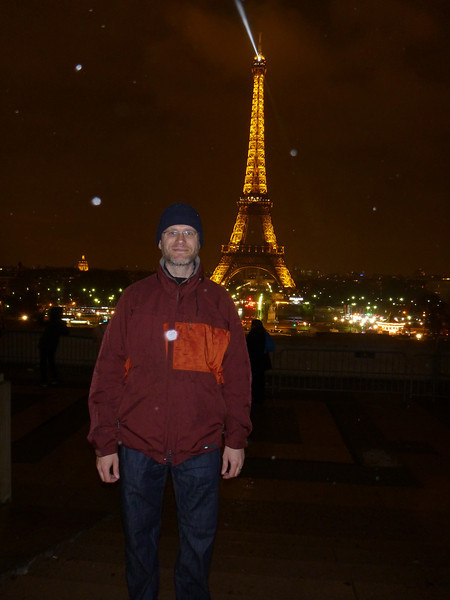 The Eiffel Tower at night, in the rain, as seen from the Trocadero in Paris, France.