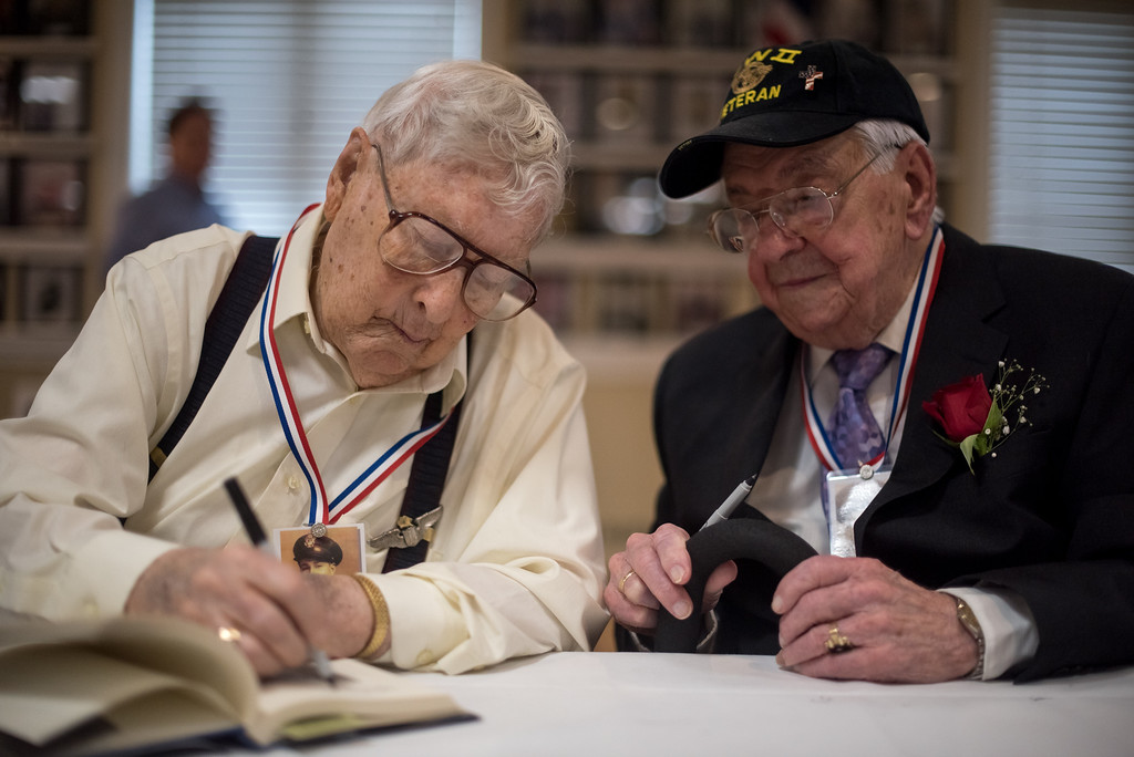 """. 03/26/17 LEOMINSTER with story-- World War II veterans Charles R. Rogers (left) and  Fernand E. Frechette (right) during Sundays book signing of \""""My Father\'s War\"""" written by local author Charley Valera.  The World War II veterans featured in the book came together on Sunday to sign books on March 26, 2017 at the Veterans Center in Leominster.  (Sentinel & Enterprise photo/Jeff Porter)"""