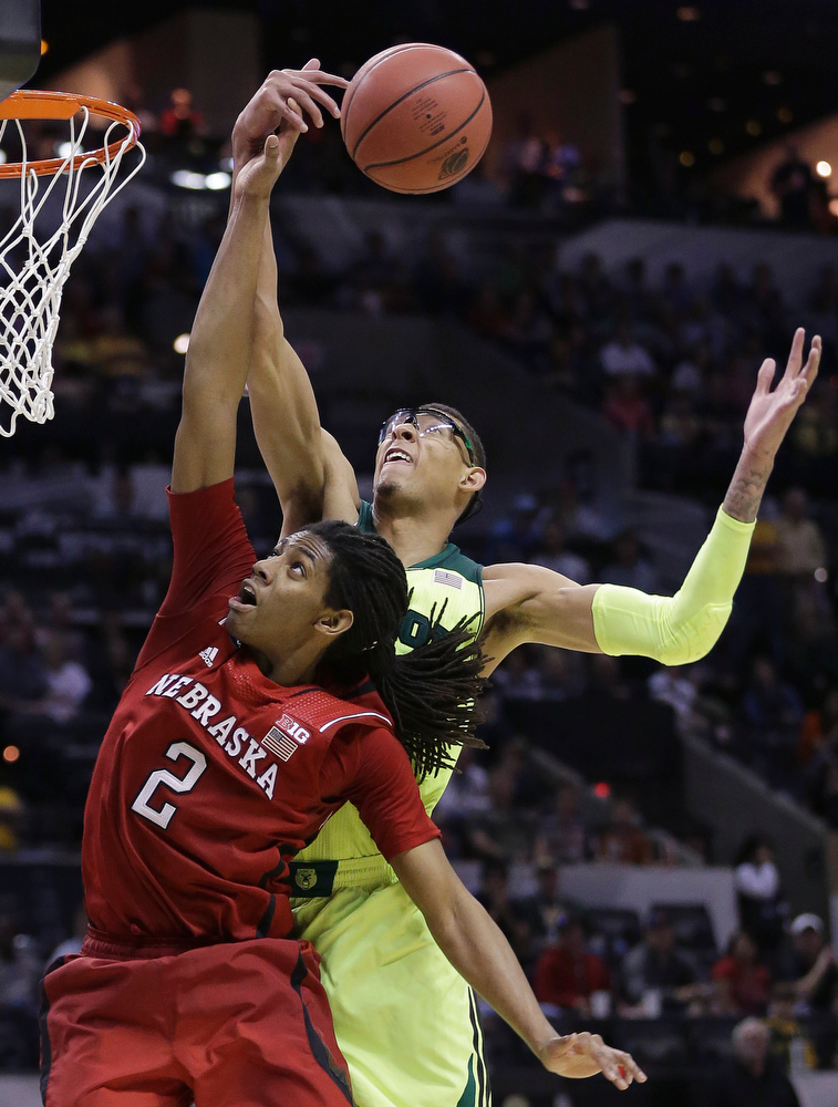 . Baylor\'s Isaiah Austin, right, grabs a rebound over Nebraska\'s David Rivers (2) during the second half of a second-round game in the NCAA college basketball tournament Friday, March 21, 2014, in San Antonio. Baylor won 74-60. (AP Photo/Eric Gay)