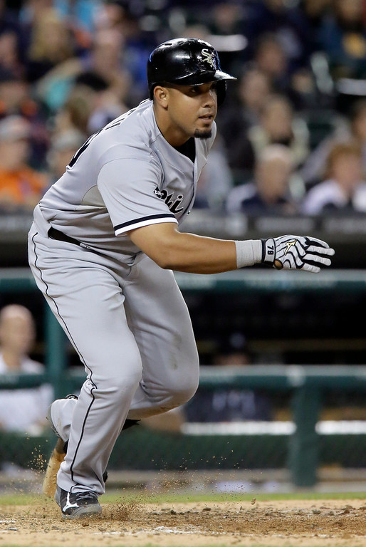 . Chicago White Sox\'s Jose Abreu doubles in the ninth inning to drive in Alexei Ramirez against the Detroit Tigers during the eighth inning of a baseball game Tuesday, July 29, 2014, in Detroit. The White Sox defeated the Tigers 11-4. (AP Photo/Duane Burleson)