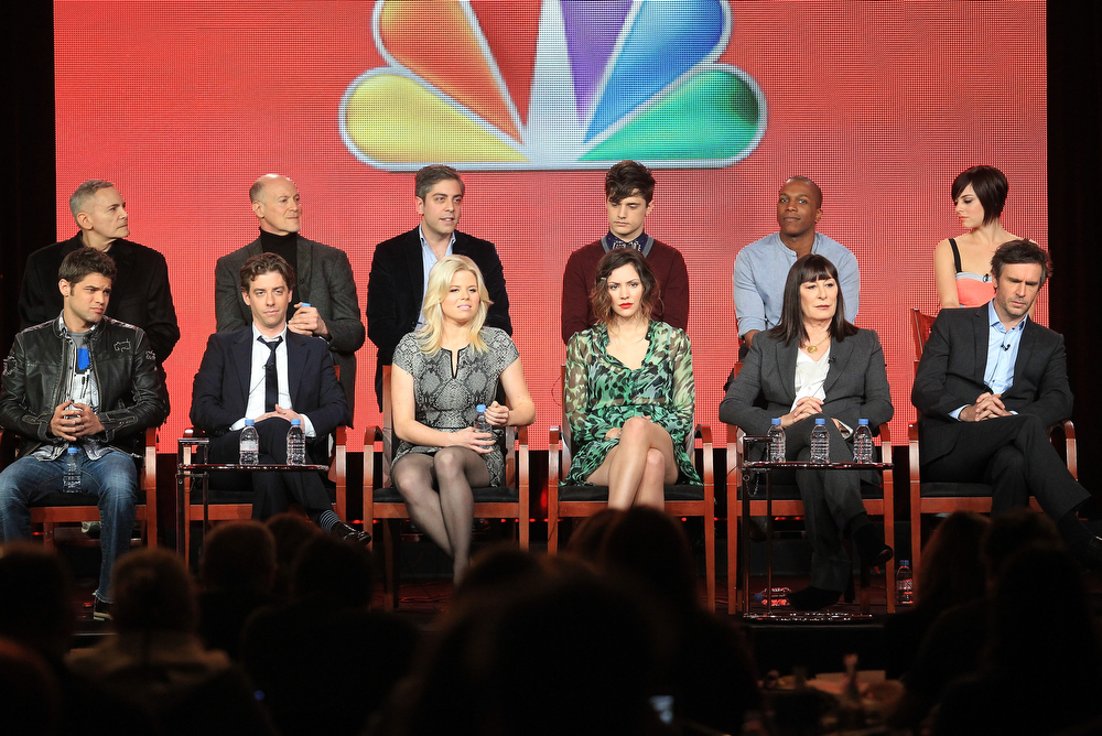 Description of . Executive Producers Craig Zadan, Neil Meron, Joshua Safran, actors Andy Mientus, Leslie Odom Jr., and Krysta Rodriguez, (Bottom L-R) actors Jeremy Jordan, Christian Borle, Megan Hilty, Katharine McPhee, Anjelica Huston, and Jack Davenport speak onstage during the