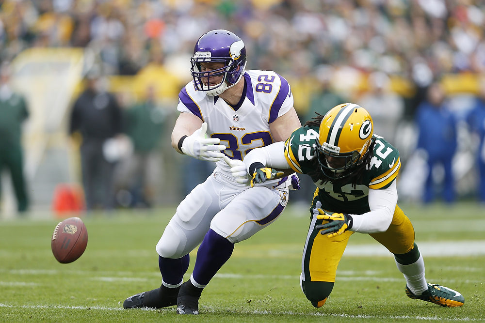 . Morgan Burnett #42 of the Green Bay Packers defends a pass against Kyle Rudolph #82 of the Minnesota Vikings during the game at Lambeau Field on December 2, 2012 in Green Bay, Wisconsin. The Packers won 23-14. (Photo by Joe Robbins/Getty Images)
