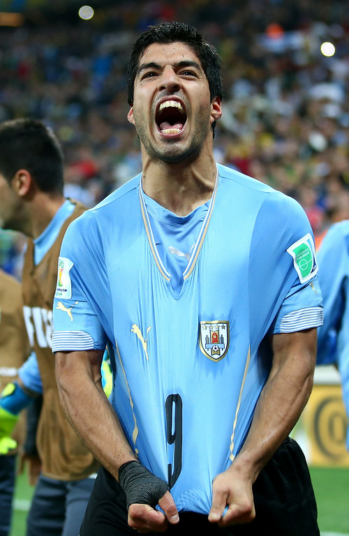. Luis Suarez of Uruguay celebrates after scoring his team\'s second goal during the 2014 FIFA World Cup Brazil Group D match between Uruguay and England at Arena de Sao Paulo on June 19, 2014 in Sao Paulo, Brazil.  (Photo by Julian Finney/Getty Images)