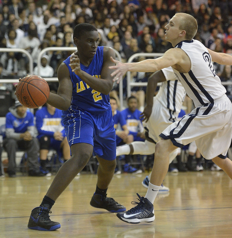 . LAKEWOOD, CALIF. USA -- La Mirada\'s Jarrett Davis (2) tries to pass the ball around Mayfair\'s Mark Patterson (2) in Lakewood, Calif., on February 8, 2013. Mayfair defeated La Mirada 60 to 59. Photo by Jeff Gritchen / Los Angeles Newspaper Group