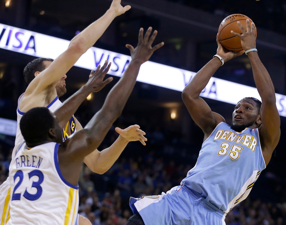 . Denver Nuggets\' Kenneth Faried, right, shoots against Golden State Warriors\' Draymond Green (23) and Andrew Bogut during the first half of an NBA basketball game Thursday, April 10, 2014, in Oakland, Calif. (AP Photo/Ben Margot)