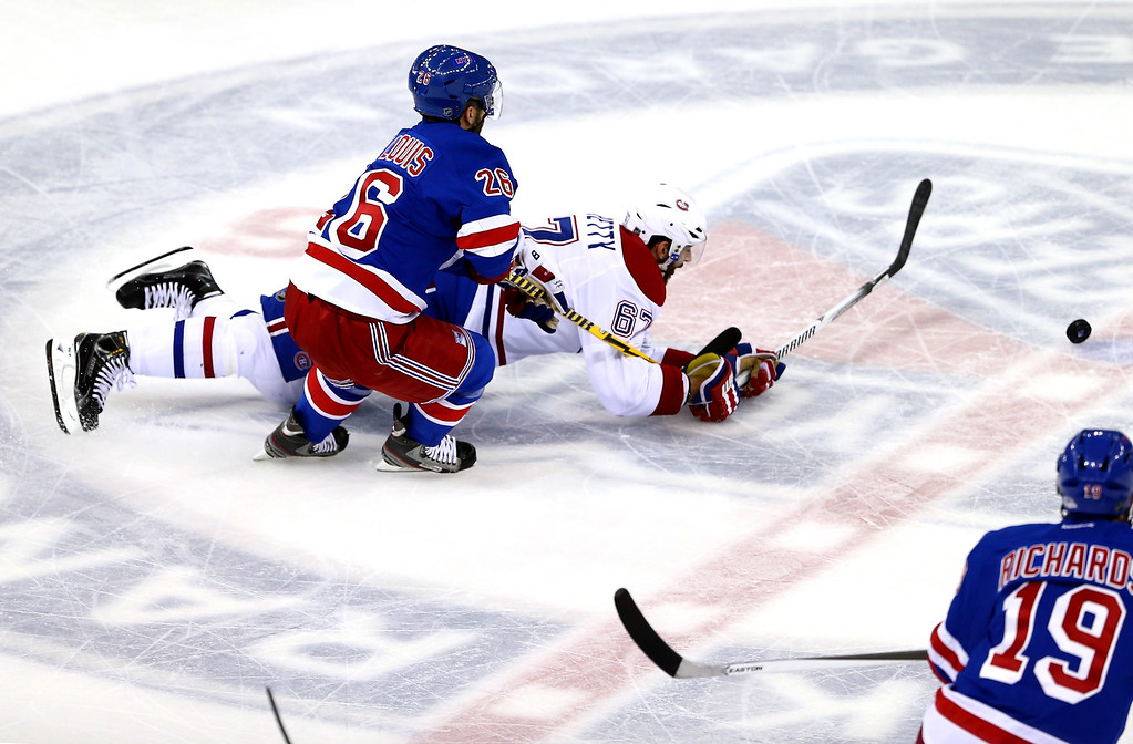 . Max Pacioretty #67 of the Montreal Canadiens falls to the ice battling for the puck against Martin St. Louis #26 of the New York Rangers  in Game Three of the Eastern Conference Final during the 2014 NHL Stanley Cup Playoffs at Madison Square Garden on May 22, 2014 in New York City.  (Photo by Elsa/Getty Images)