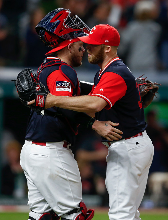 . Cleveland Indians starting pitcher Cody Allen, right, and Roberto Perez celebrate a 4-0 victory over the Kansas City Royals in a baseball game, Saturday, Aug. 26, 2017, in Cleveland. (AP Photo/Ron Schwane)