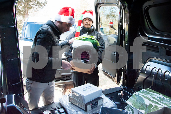 12/20/17 Wesley Bunnell | Staff Papas Dodge delivered donations to the Prudence Crandall Center on Wednesday afternoon as part of its fill the van drive held over the last several weeks. Household items were collected at the dealership such as bedding, clothes, small appliances and other household necessities clients of the center who are victims of domestic violence. Papa's Dodge Jordan McMahon hands items off to Detail Department Supervisor Eugenio Rosario.