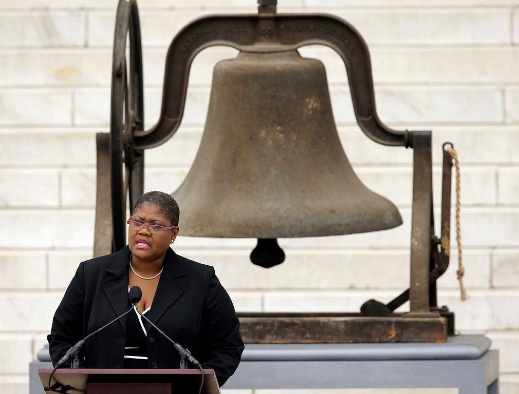 """. Melanie Campbell, president & CEO of the National Coalition on Black Civic Participation, speaks at the Let Freedom Ring ceremony at the Lincoln Memorial in Washington, Wednesday, Aug. 28, 2013, to commemorate the 50th anniversary of the 1963 March on Washington for Jobs and Freedom. It was 50 years ago today when Martin Luther King Jr. delivered his \""""I Have a Dream\"""" speech from the steps of the memorial. The bell at rear rang at the 16th St Baptist Church in Birmingham, Ala. which was bombed 18 days after the March On Washington killing four young girls.  (AP Photo/Carolyn Kaster)"""